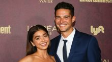 Sarah Hyland's boyfriend, Wells Adams, hits back at a rude comment about her bikini selfie post