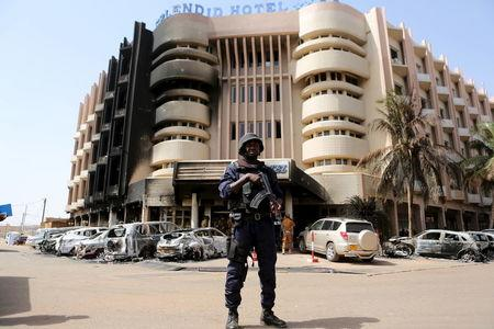 A soldiers stands guard in front of Splendid Hotel in Ouagadougou