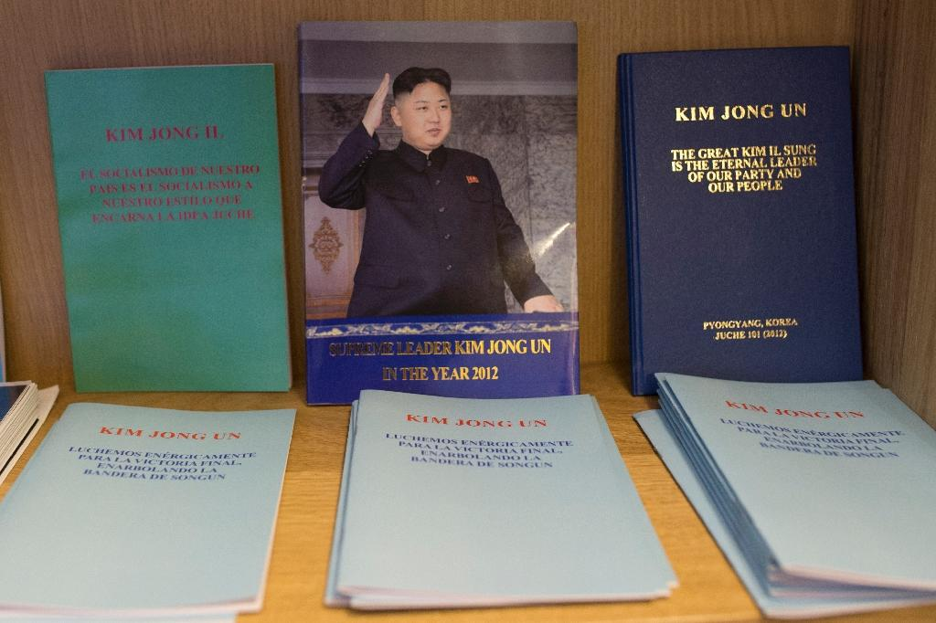 """The """"Pyongyang Cafe"""" features a bookshelf full of works by leaders of the Kim dynasty that has ruled North Korea since 1948 (AFP Photo/Josep Lago)"""
