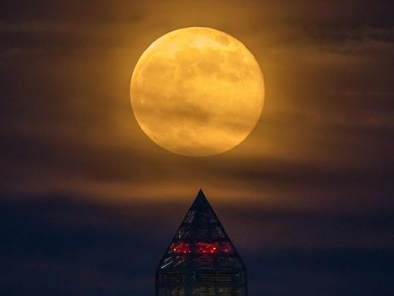 A supermoon rises over the Washington Monument on June 23, 2013.
