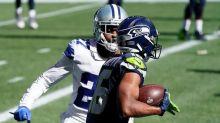 The Latest: Seahawks' Wilson has thrown 4 TD passes again