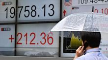 Asian shares waver after Wall Street closes at record levels