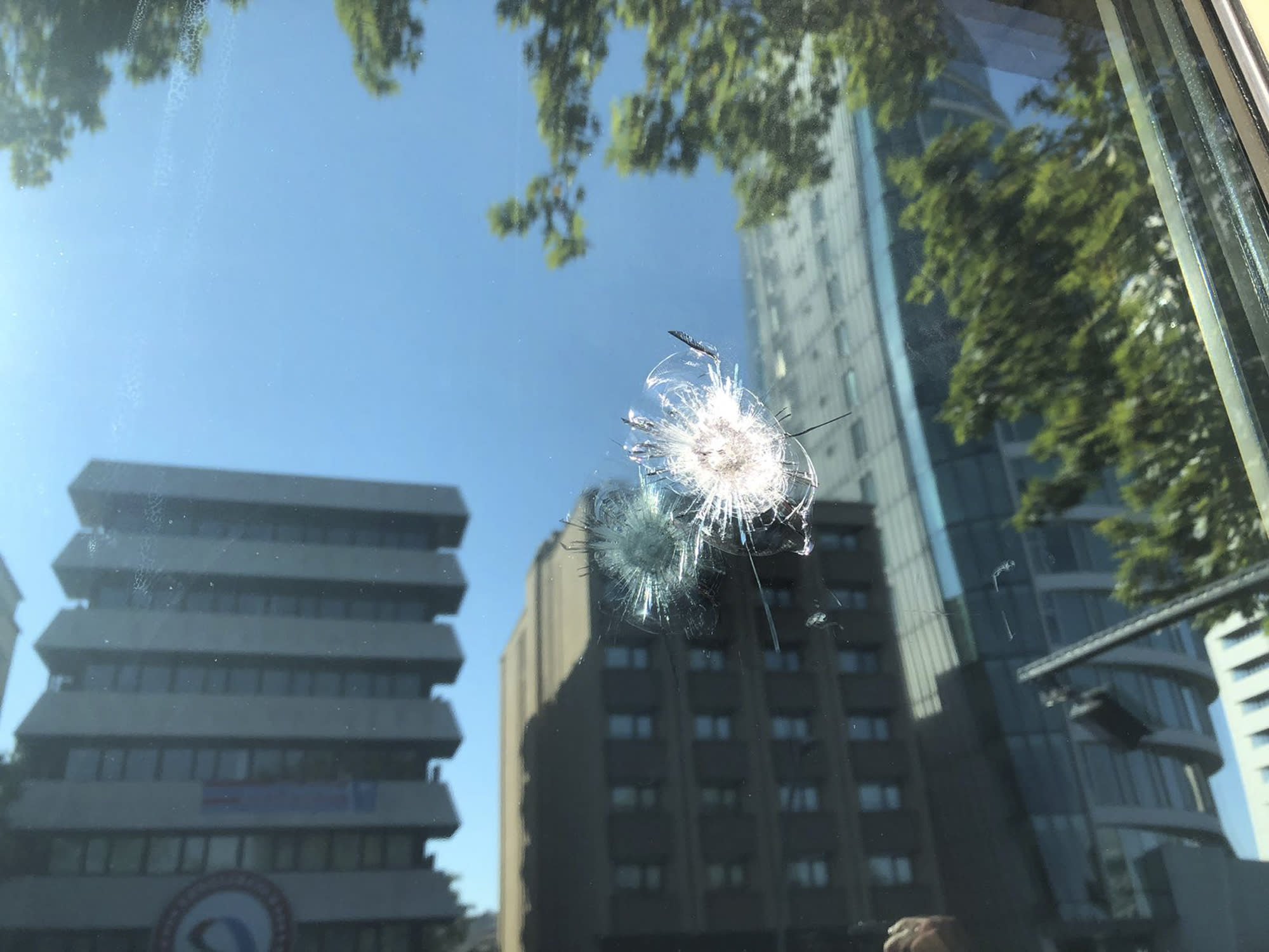 The damage to a security booth by a shot fired, is seen outside the U.S. Embassy in Ankara, Turkey, Monday, Aug. 20, 2018. Shots were fired at a security booth outside the embassy in Turkey's capital early Monday, but U.S. officials said no one was hurt. Ties between Ankara and Washington have been strained over the case of an imprisoned American pastor, leading the U.S. to impose sanctions, and increased tariffs that sent the Turkish lira tumbling last week. (AP Photo/Burhan Ozbilici)
