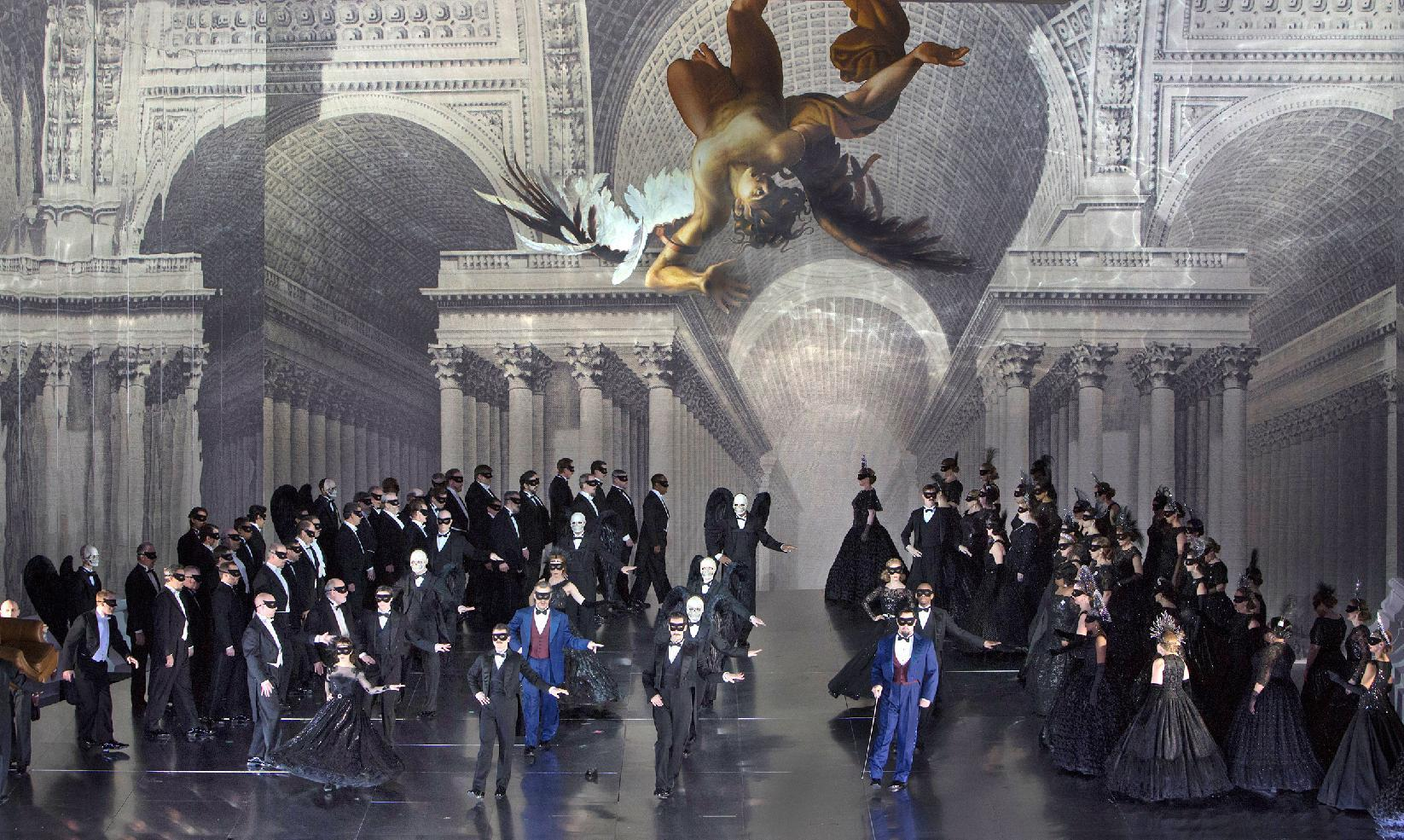 """In this Nov. 5, 2012, photo provided by the Metropolitan Opera, a scene from Verdi's """"A Masked Ball"""" is performed during a dress rehearsal at the Metropolitan Opera in New York. (AP Photo/Ken Howard)"""