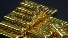 Gold slips to one-year low as U.S. dollar firms