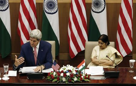 U.S. Secretary of State Kerry addresses the media as India's External Affairs Minister Swaraj looks on during their joint news conference New Delhi