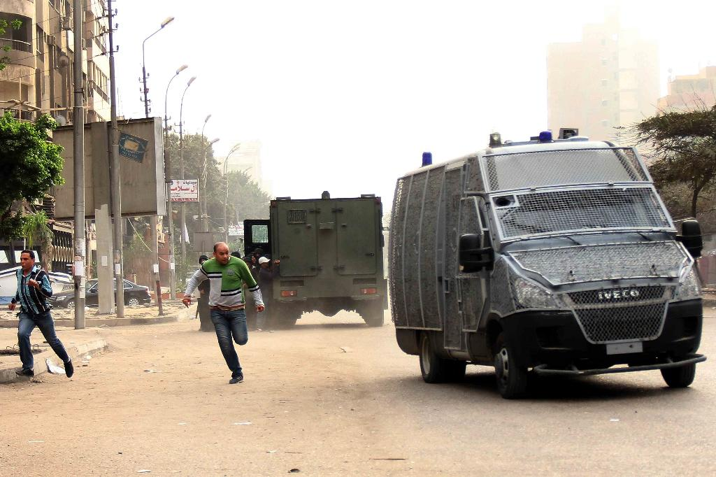Egyptian police vehicles at a demonstration in Cairo