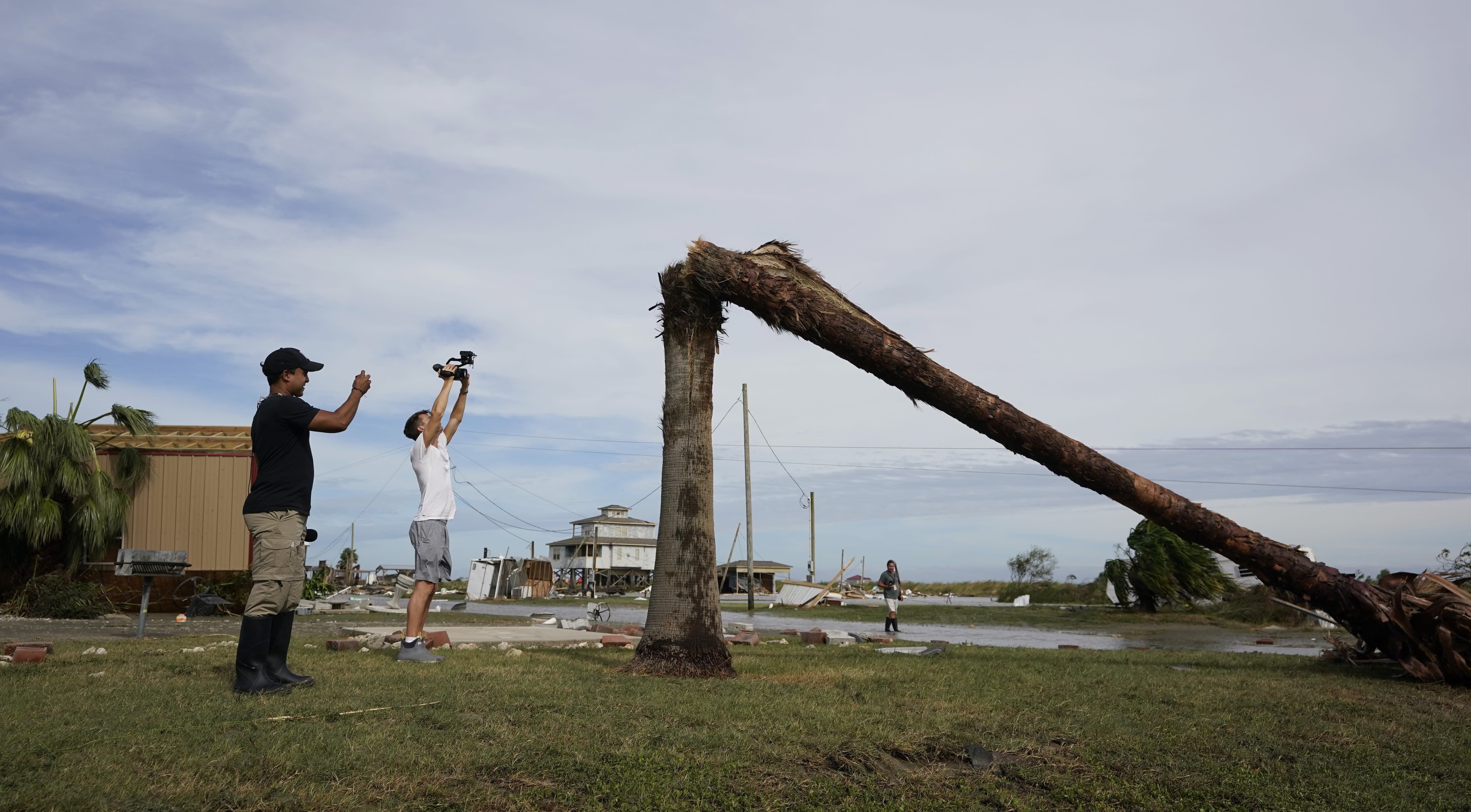 Journalists examine damage left in the wake of Hurricane Laura, Thursday, Aug. 27, 2020, in Holly Beach, La. (AP Photo/Eric Gay)