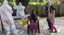 Asia Today: India reports record 1,133 new virus deaths