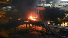 Fires rage around besieged Hong Kong campus as protesters dig-in