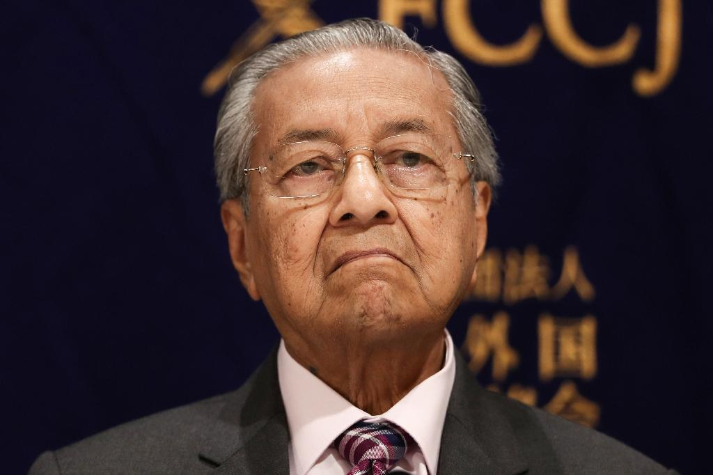 """Malaysia's Mahathir Mohamad, whose country forms part of the Dutch-led criminal investigation into the crash, caused consternation with his comments that charging three Russians and a Ukrainian was """"ridiculous"""" and """"politically motivated"""" (AFP Photo/Behrouz MEHRI)"""