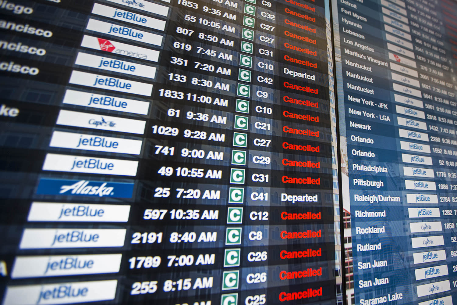 <p>The information board in Terminal C at Logan International Airport shows the majority of flights cancelled as a winter storm bears down on the area, March 14, 2017 in Boston. (Scott Eisen/Getty Images) </p>