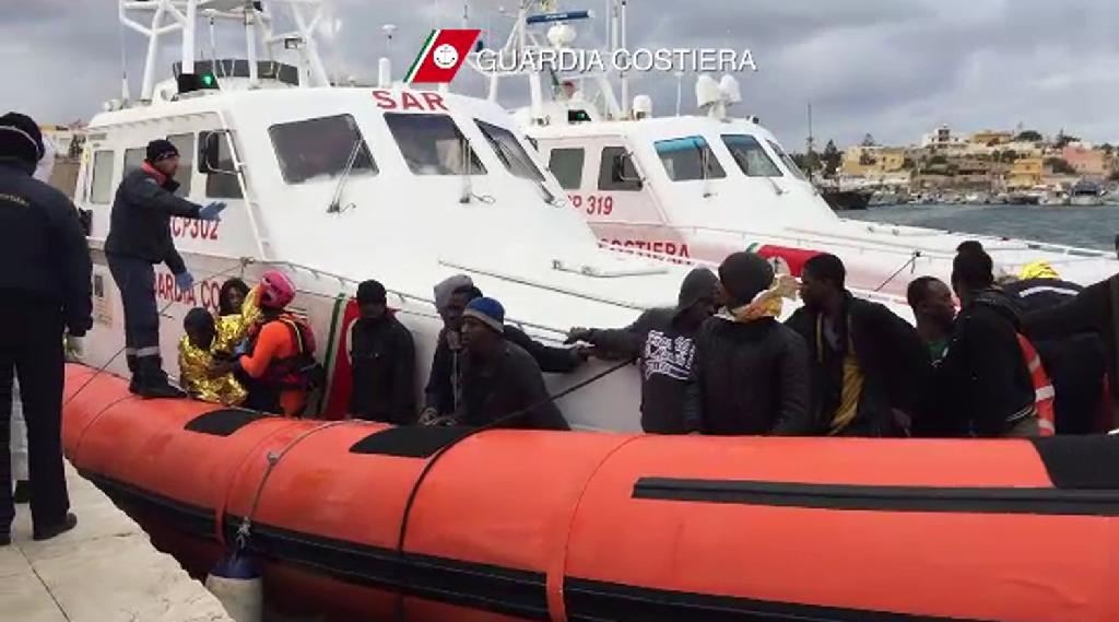 Handout picture released by the Italian Coast Guards (Guardia Costiera) on February 10, 2015, shows migrants disembarking after a rescue operation off the coast of Lampedusa (AFP Photo/)