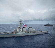 US warship sustains minor damage after tug drifts off Japan