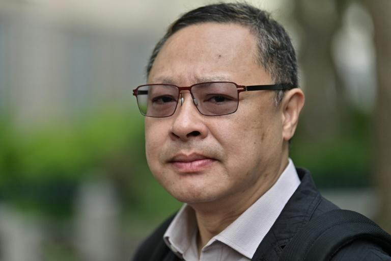 Benny Tai wrote from jail that violence was the conclusion of Beijing ignoring years peaceful rallies (AFP Photo/Anthony WALLACE)