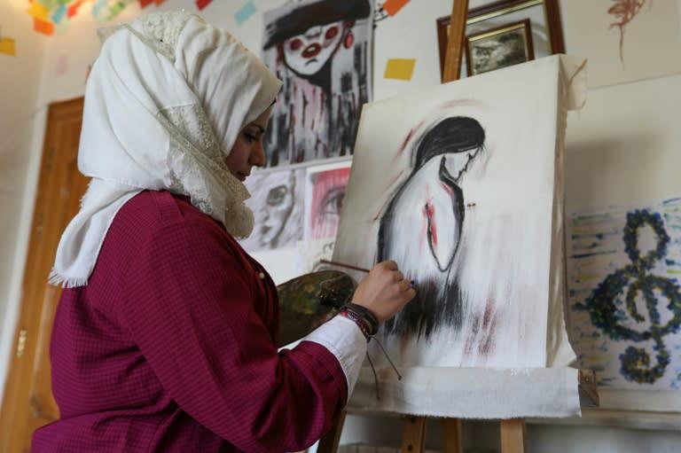 Through her cartoons, Amani al-Ali has boldly challenged traditions (AFP Photo/Omar HAJ KADOUR)