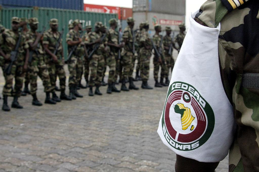 A Senegalese soldier wearing the colours of the ECOWAS force. This picture shows troops arriving in Abidjan on 18 January 2002