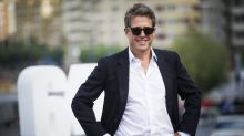 Hugh Grant says that filming sex scenes is a 'turn on'