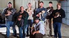 Men on stag do adopt seven newborn puppies after stray dog leads them to her babies