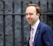 Britain is at COVID-19 tipping point, health minister says