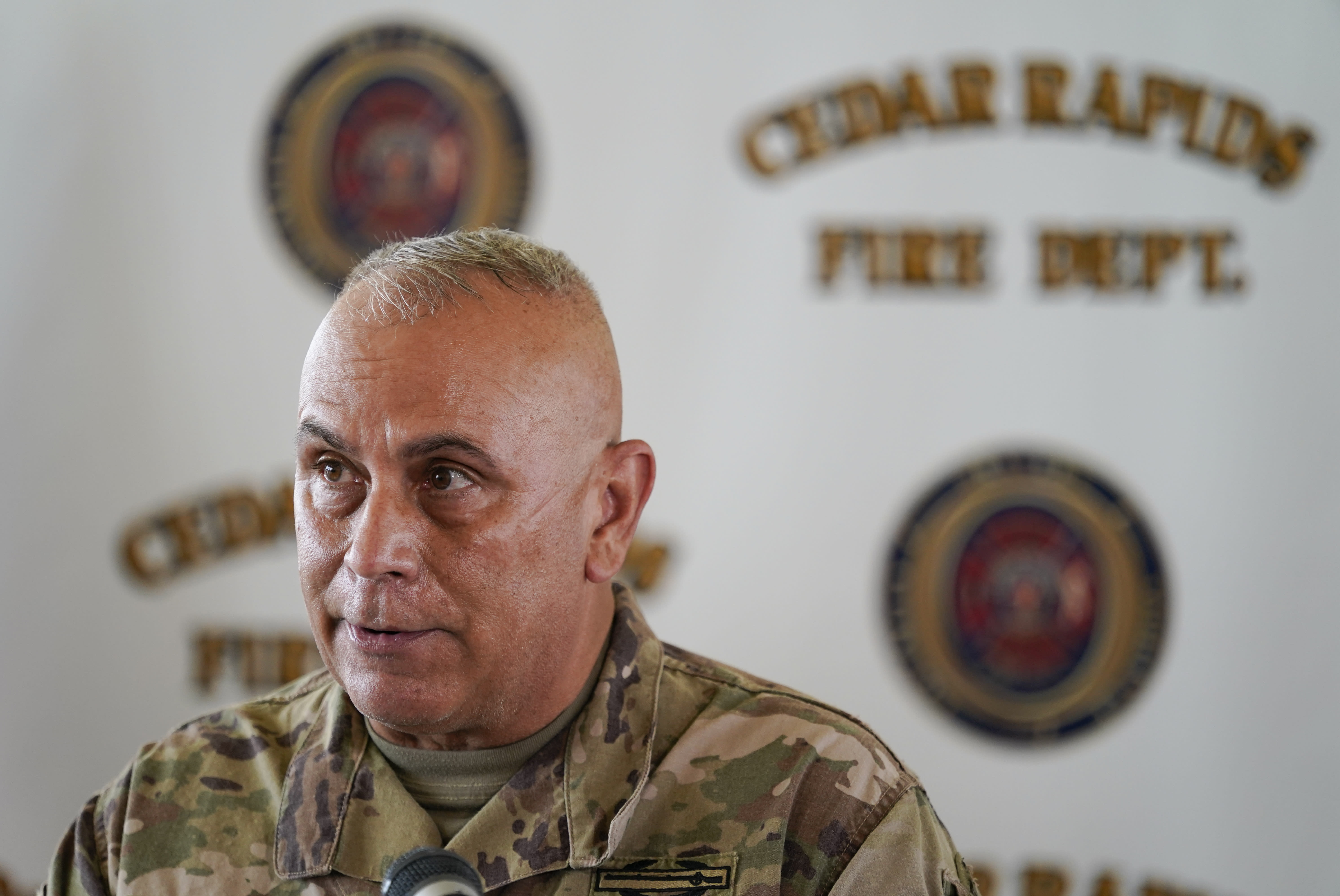 Iowa National Guard commander Adjutant General Benjamin Corell speaks during a news conference, Friday, Aug. 14, 2020, in Cedar Rapids, Iowa. Gov. Kim Reynolds pushed back Friday against criticism that she has been slow to respond to a wind storm that devastated the state and promised more help soon for tens of thousands of residents entering their fifth day without electricity. (AP Photo/Charlie Neibergall)