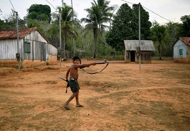 The tribe has vowed to fight to the death against land invasions (AFP Photo/CARL DE SOUZA)