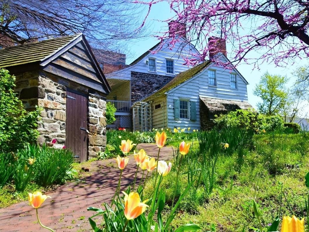 An image of the garden at the Dyckman Farmhouse Museum in Inwood.