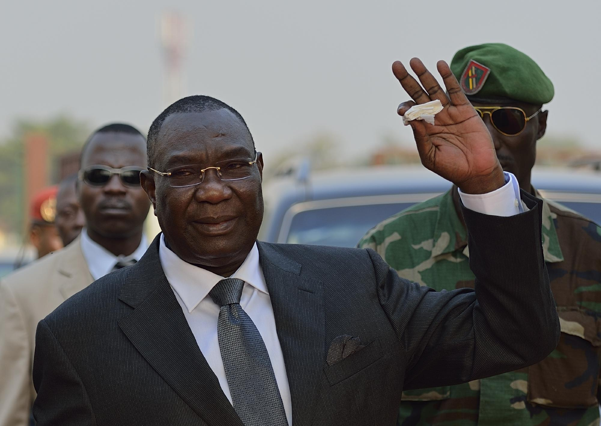 Then Central African Republic president Michel Djotodia gestures as he arrives at Mpoko Bangui airport on his way to N'Djamena to attend a summit on the unrest in the CAR, January 8, 2014 (AFP Photo/Eric Feferberg)