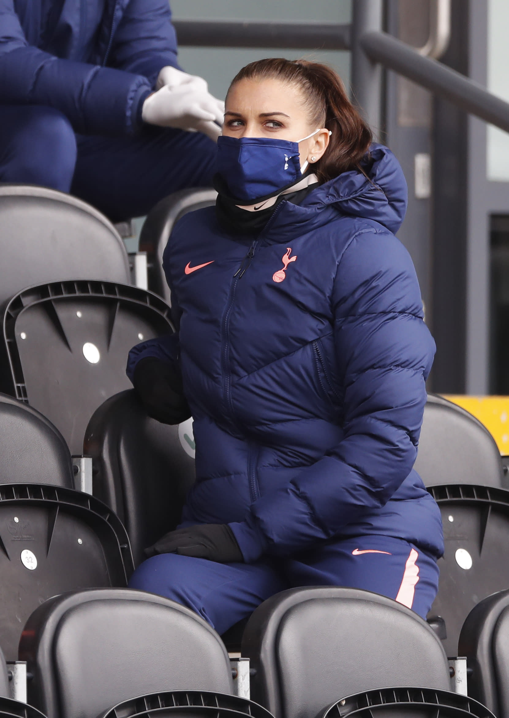 Tottenham Hotspur's Alex Morgan sits in the stands during the English Women's Super League match between Tottenham Hotspur and Manchester United at the Hive stadium in London Saturday, Oct 10 2020. (AP Photo/Alastair Grant)