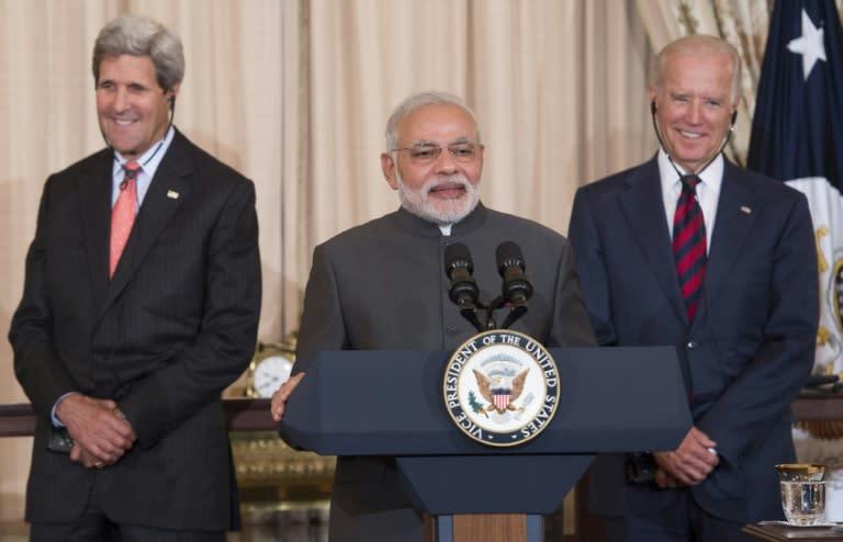 Indian Prime Minister Narendra Modi speaks alongside then US vice president Joe Biden (right) and secretary of state John Kerry in Washington in 2014 (AFP Photo/SAUL LOEB)