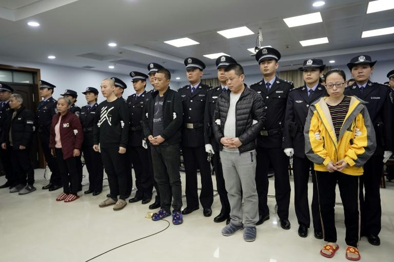 China's jailing of nine people Thursday for trafficking and selling fentanyl to US buyers followed a rare joint probe with US law enforcement (AFP Photo/Handout)
