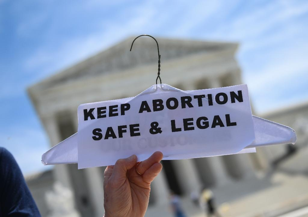 An abortion rights protester holds up a sign outside the US Supreme Court