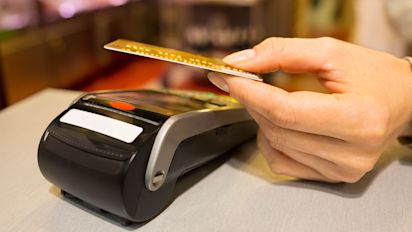 Tap-and-go cards overtake chip and PIN in shops for the first time