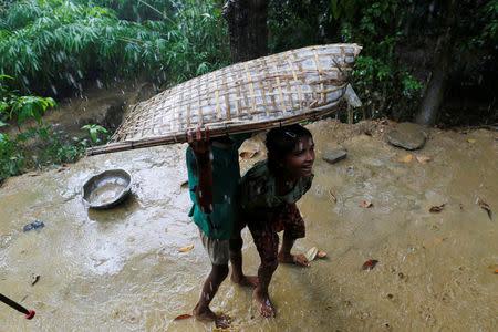 Rohingya Muslim boys are pictured in U Shey Kya village outside Maugndaw, in Rakhine state, Myanmar October 27, 2016. REUTERS/Soe Zeya Tun