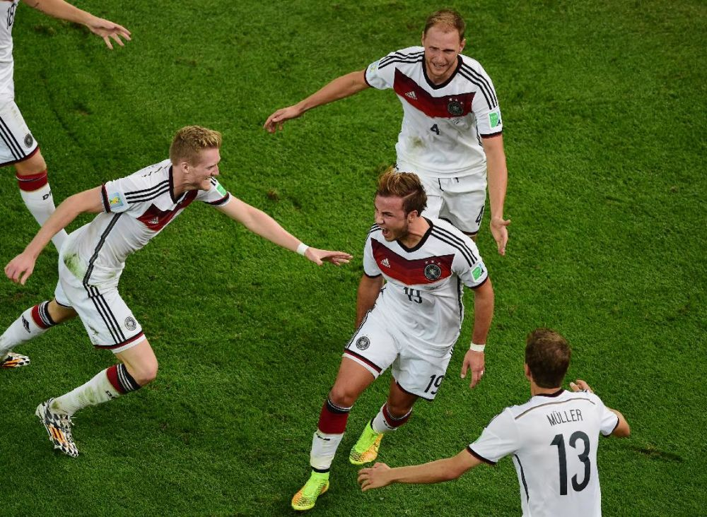 Germany's Mario Goetze, center, celebrates scoring his side's first goal during the World Cup final soccer match between Germany and Argentina at the Maracana Stadium in Rio de Janeiro, Brazil, Sunday, July 13, 2014