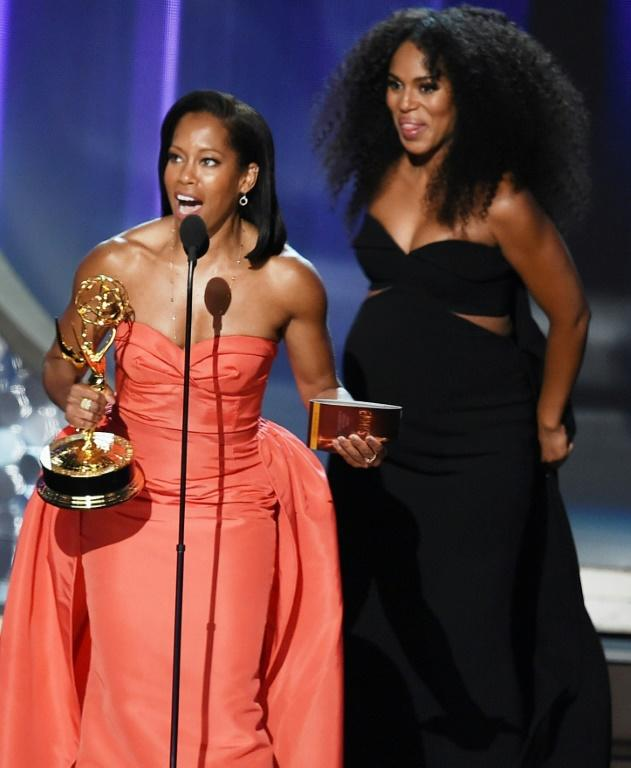 Regina King (L) and Kerry Washington are among the record number of black actors nominated for Emmys this year (AFP Photo/KEVIN WINTER)