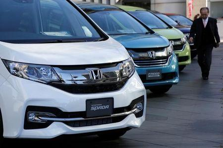 Man Walks Past Honda Motor Cars Outside The Company39s Headquarters