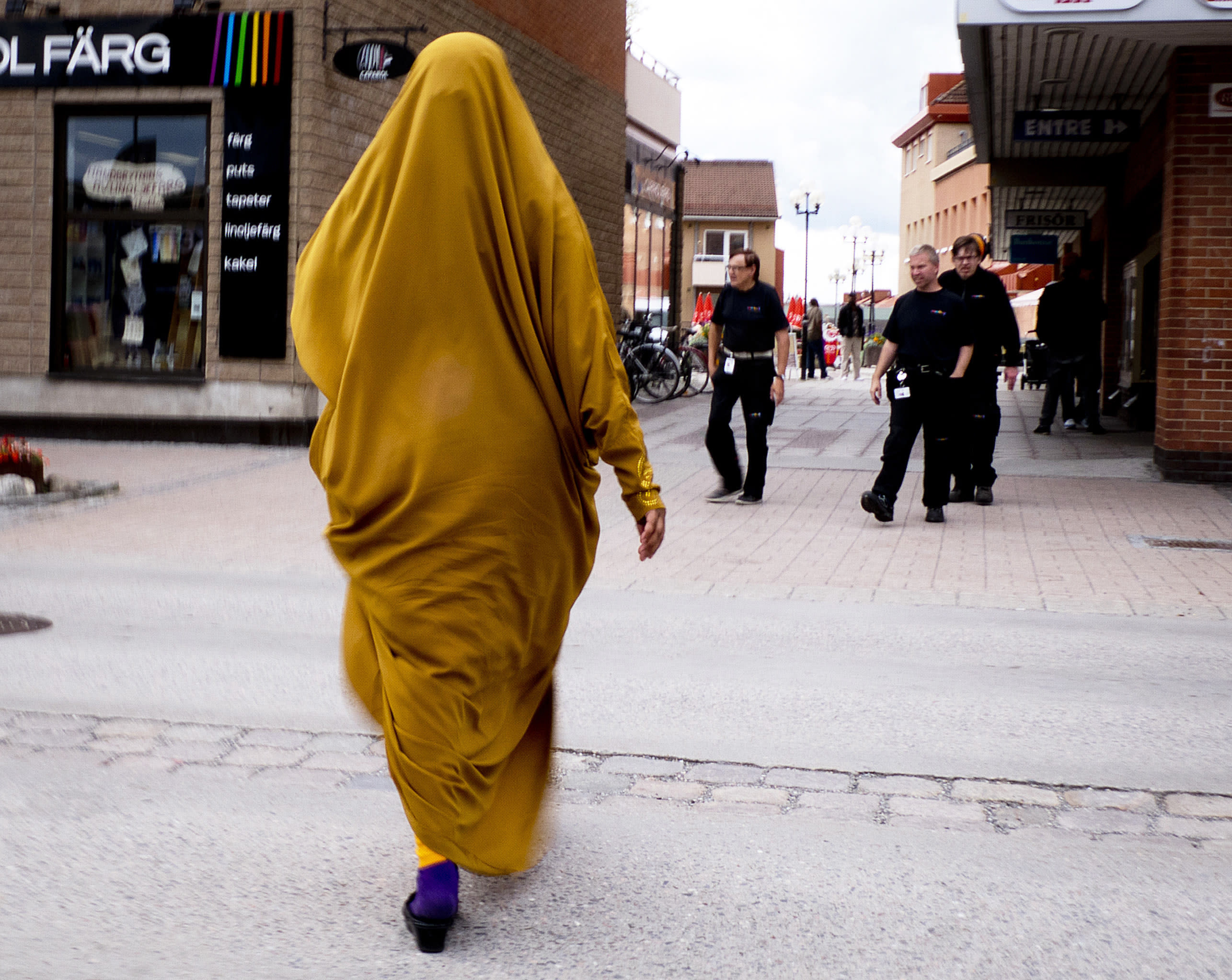 In this Aug. 30, 2018 photo a migrant from Somalia walks through downtown Flen, some 100 km west of Stockholm, Sweden. The town has welcomed so many asylum seekers in recent years that they now make up about a fourth of the population. (AP Photo/Michael Probst)