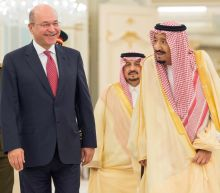 Iraq's president meets Saudi king after visiting rival Iran