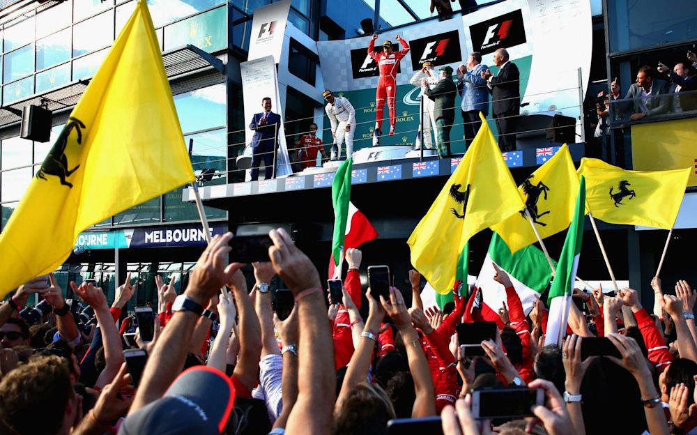 Sebastian Vettel celebrates victory on the podium - Getty Images AsiaPac
