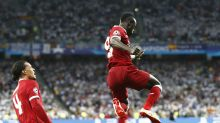 The Latest: Liverpool levels with Real Madrid at 1-1