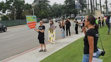 'It's not a sport': Animal rights advocates march for the abolishment of horse racing