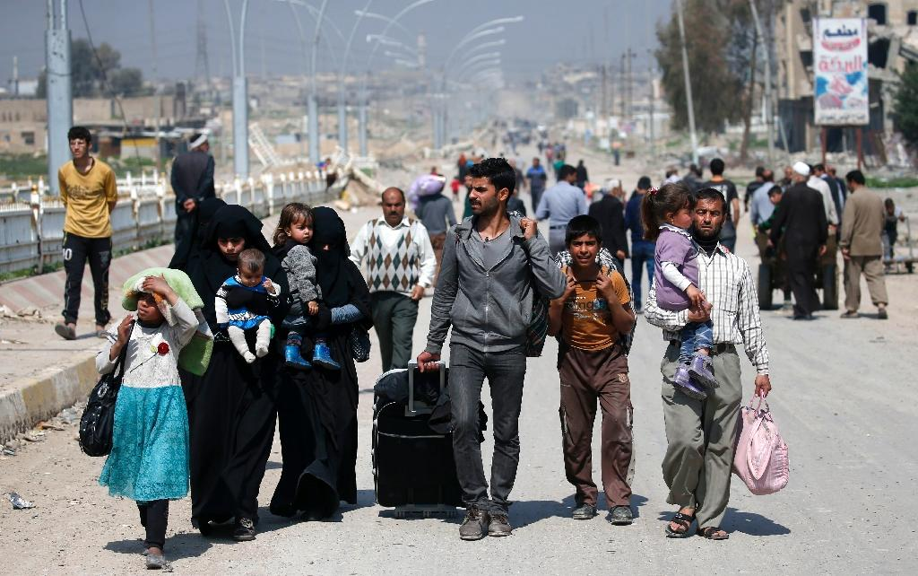 The corridor is secured by forces from the elite Counter-Terrorism Service and other units but mortar rounds still whizzed over the streams of displaced (AFP Photo/AHMAD GHARABLI)