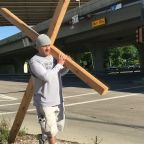 Man carrying cross on Good Friday says he hopes to remind others of true meaning of Easter