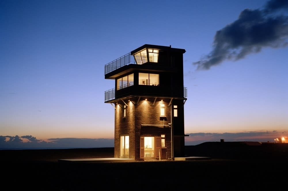 """A unique former radar station, <a href=""""https://www.mulberrycottages.com/cottage/holiday-cottages-in-kent/84210-coastguard-lookout/"""" target=""""_blank"""">Coastguard Lookout</a> is situated by the seaside in Dungeness and offers uninterrupted views of the sea, just a few steps from the water's edge. An ideal holiday rental for the family, the property sleeps five and features an open-plan kitchen from where parents can watch the children play outside. Spread over four floors, the modern property offers unparalleled views of the coast and the Kent countryside around. From £201 per night."""