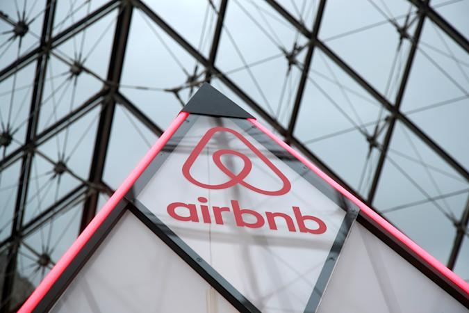 """The Airbnb logo is seen on a little mini pyramid under the glass Pyramid of the Louvre museum in Paris, France, March 12, 2019. Airbnb and the Louvre museum will offer the chance to spend a night in the Louvre museum on April 30 where a contest winner with a guest will have an aperitif in front of the painting """"Mona Lisa"""" (La Joconde) by Leonardo Da Vinci, a dinner in front of the Venus de Milo statue during a private visit and finally sleep in their own little mini pyramid under the glass Pyramid. Picture taken March 12, 2019. REUTERS/Charles Platiau"""