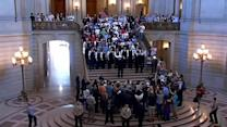 Same-sex marriages begin at City Hall