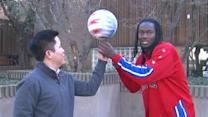Globetrotter teaches ABC30's Tommy Tran a new trick