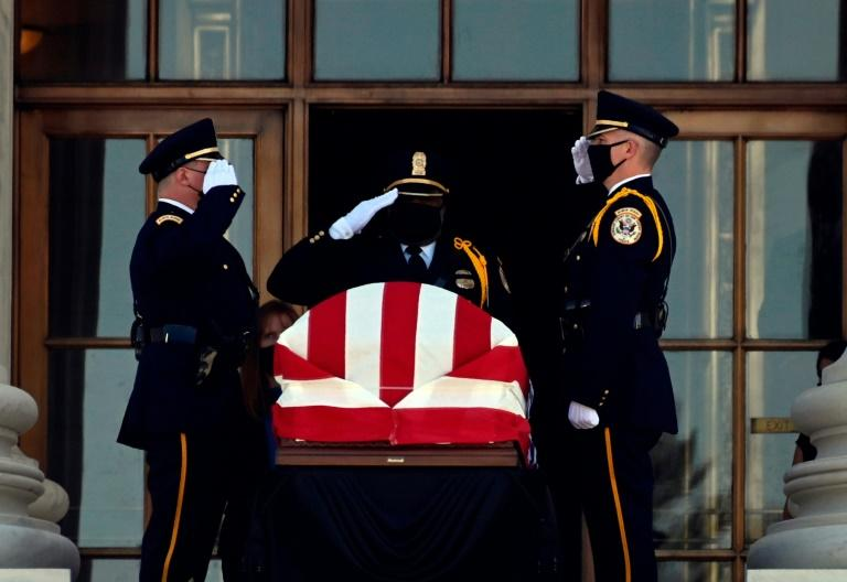 The casket of Ruth Bader Ginsburg is brought to the front of the Supreme Court for two days of public viewing