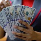 Dollar, equities gain on upbeat data, Microsoft